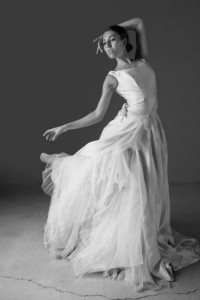 Dancer posing in ornate gown