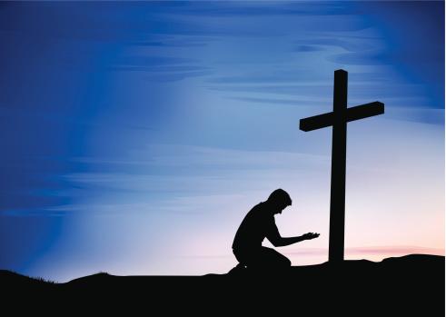 Kneeling at Cross
