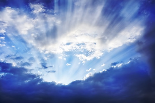 Sun Rays Behind the Clouds.Bright Sky